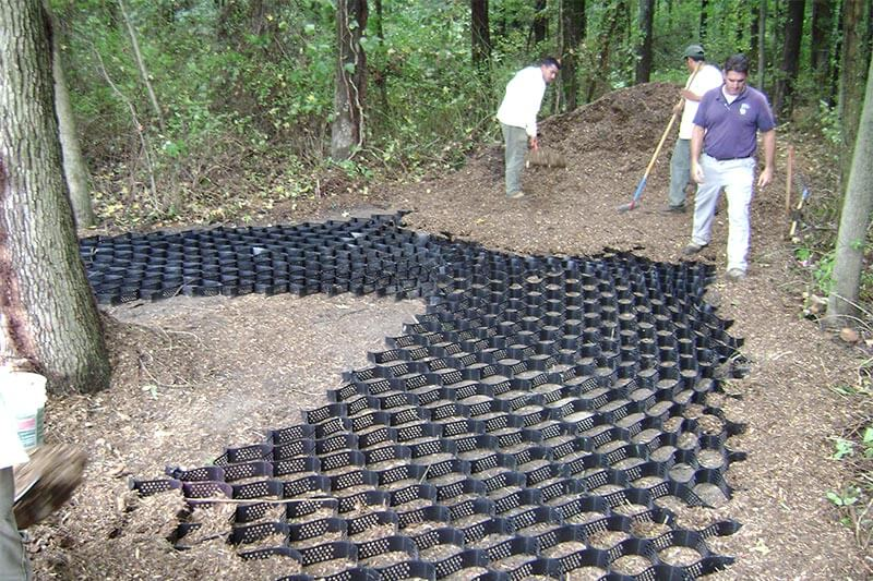 Nature trail construction permeable geoweb installation at trail entrance